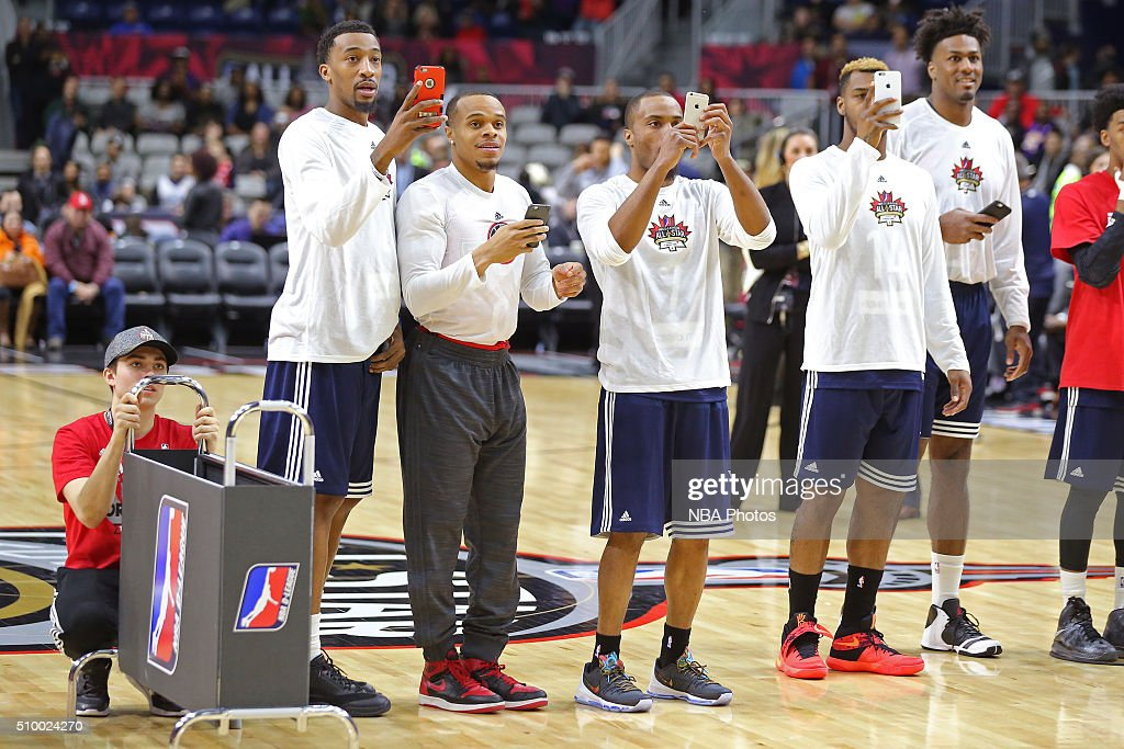 Players line up with their smart phones during the NBA D-League All-Star 3 Point Contest, presented by Kumho Tire, as part of 2016 All-Star Weekend at the Ricoh Coliseum on February 13, 2016 in Toronto, Ontario, Canada.