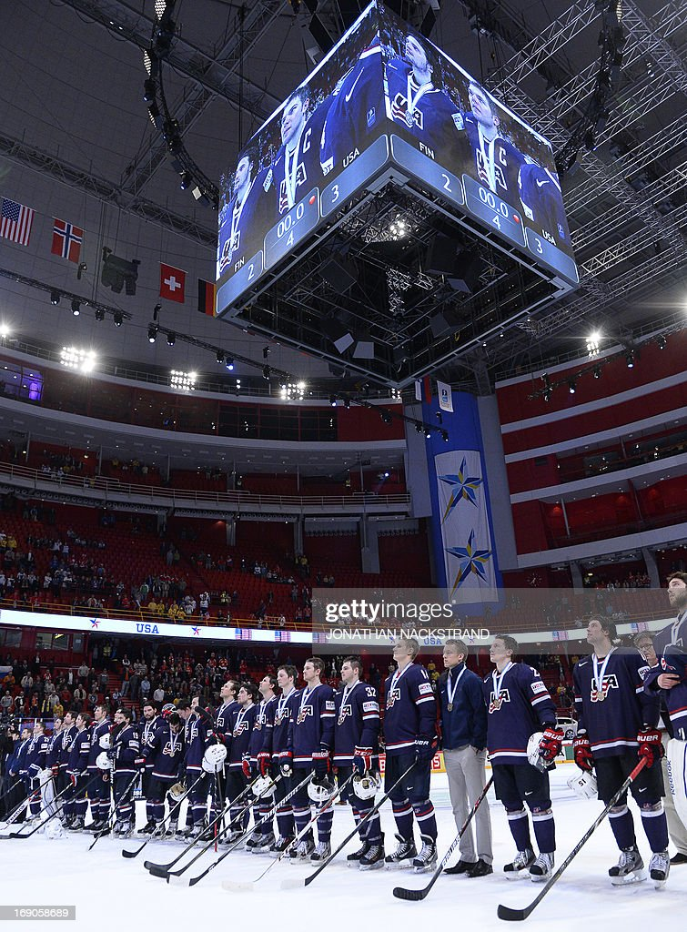 US players listen to their national anthem with their bronze medal after the IIHF Ice Hockey World Championship bronze medal match Finland vs USA on May 19, 2013 in Stockholm. USA won 3-2.