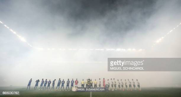 TOPSHOT Players listen to their respective national anthems before the Brazil Corinthians vs Chile's Universidad de Chile for the 2017 Sudamericana...