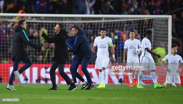 PSG players look dejected as Luis Enrique manager of Barcelona celebrates with coaching staff as Sergi Roberto of Barcelona scores their sixth goal...