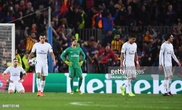 PSG players look dejected as Sergi Roberto of Barcelona scores their sixth goal during the UEFA Champions League Round of 16 second leg match between...