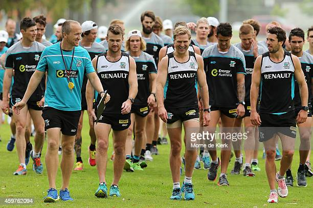 Players look on after completing the timetrial during a Port Power AFL preseason training session at The Uni Loop on December 1 2014 in Adelaide...