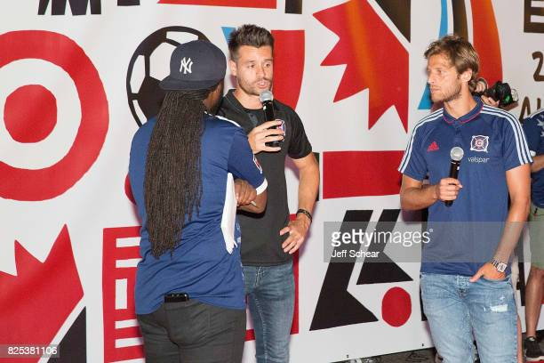 MLS Players Luis Solignac and Joao Meira of the Chicago Fire attend the Chicago Tribune Bulding Light Installation at the Target MLS AllStar Fan...