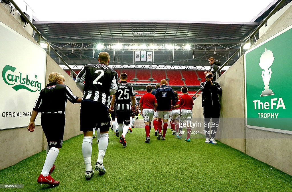 Players majke their way onto the pitch ahead of the FA Trophy Final between Wrexham and Grimsby Town at Wembley Stadium on March 24, 2013 in London, England.