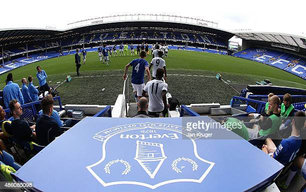 Players make their onto the pitch during the Premier League International Cup between Everton U21 and Tottenham Hotspur U21 at Goodison Park on...