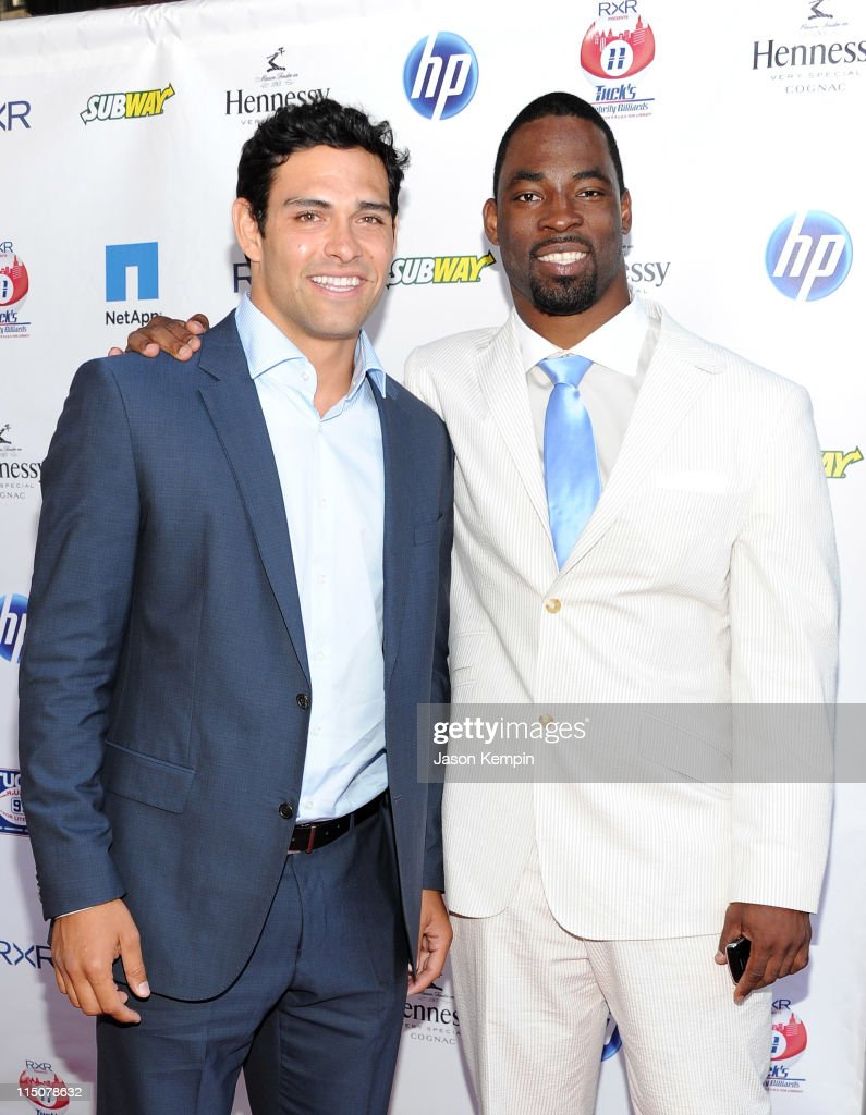 Players Mark Sanchez and Justin Tuck attend NY Giants Justin Tuck's 3rd Annual Celebrity Billiards Tournament at Slate on June 2 2011 in New York City