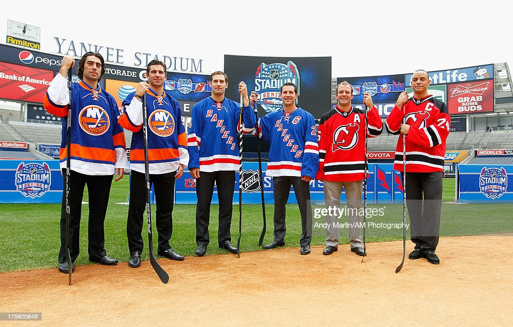 NHL players (L-R) <a gi-track='captionPersonalityLinkClicked' href=/galleries/search?phrase=Matt+Moulson&family=editorial&specificpeople=3365493 ng-click='$event.stopPropagation()'>Matt Moulson</a> and <a gi-track='captionPersonalityLinkClicked' href=/galleries/search?phrase=John+Tavares&family=editorial&specificpeople=601791 ng-click='$event.stopPropagation()'>John Tavares</a> of the New York Islanders, Dan Girardi and <a gi-track='captionPersonalityLinkClicked' href=/galleries/search?phrase=Ryan+Callahan&family=editorial&specificpeople=809690 ng-click='$event.stopPropagation()'>Ryan Callahan</a> of the New York Rangers, and <a gi-track='captionPersonalityLinkClicked' href=/galleries/search?phrase=Andy+Greene&family=editorial&specificpeople=3568726 ng-click='$event.stopPropagation()'>Andy Greene</a> and <a gi-track='captionPersonalityLinkClicked' href=/galleries/search?phrase=Bryce+Salvador&family=editorial&specificpeople=208746 ng-click='$event.stopPropagation()'>Bryce Salvador</a> of the New Jersey Devils pose for a photo during the 2014 NHL Stadium Series Media Availabilty at Yankee Stadium on August 8, 2013 in New York City.