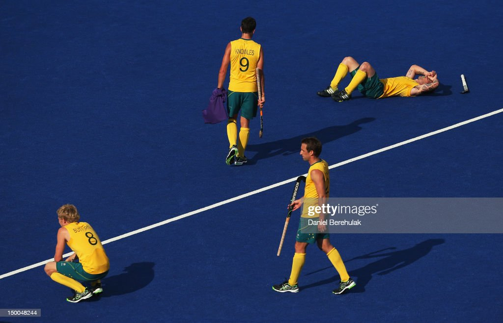 Players Matthew Butterini, Mark Knowles, Kieran Govers and De Young of Australia react after losing the match after the Men's Hockey semi-final match between Australia and Germany on Day 13 of the London 2012 Olympic Games at Riverbank Arena Hockey Centre on August 9, 2012 in London, England.