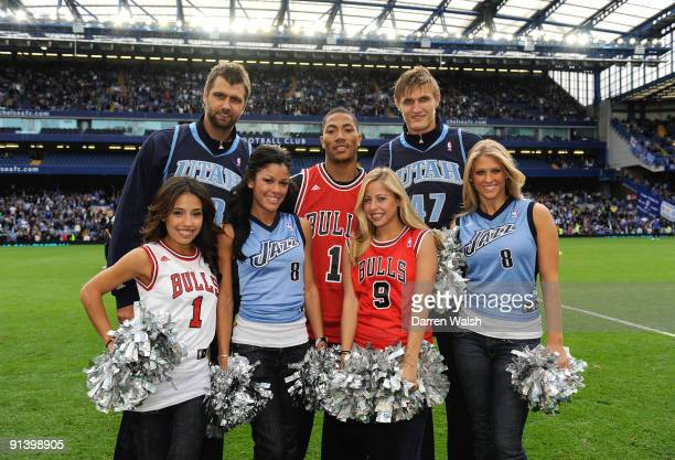 NBA players Mehmet Okur Derrick Rose and Andrei Kirilenko and cheerleaders at half time during the Barclays Premier League match between Chelsea and...