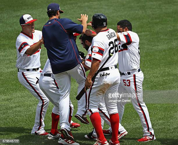 Players mob Adam Eaton of the Chicago White Sox after he got the game winning hit a single in the 9th inning against the Detroit Tigers in a game...