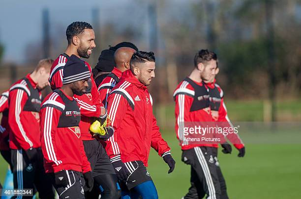 Players Nathan Dyer Kyle Bartley Neil Taylor and Matty Grimes chatting to each other before the Swansea City Training Session on January 21 2015 in...