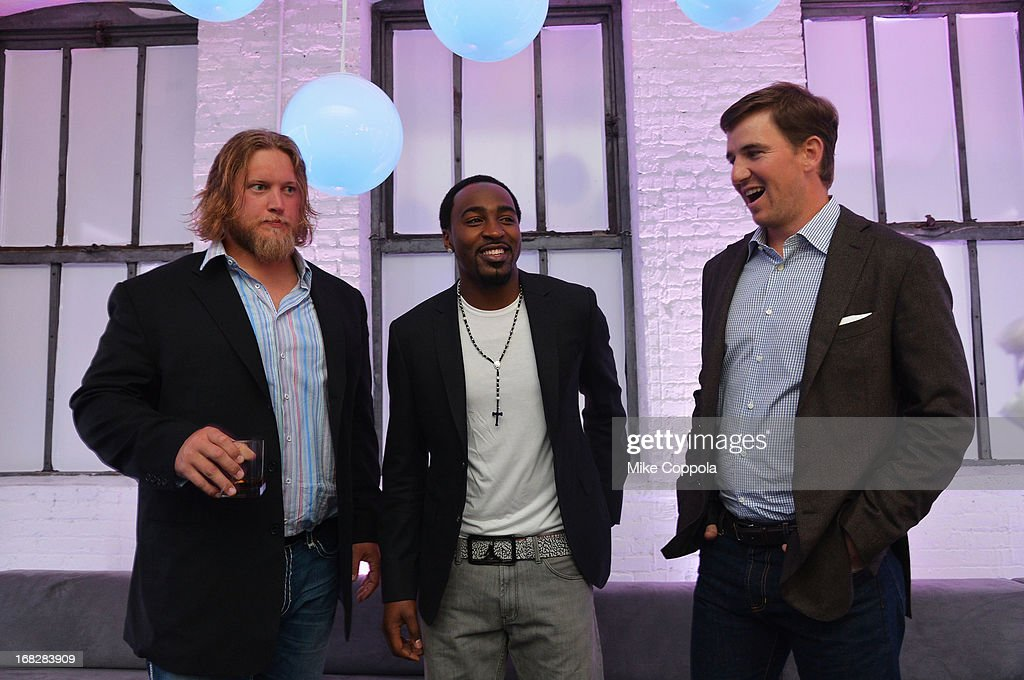 NFL players Nick Mangold, Hakeem Nicks and Eli Manning attend DIRECTV's 2013 National Ad Sales Upfront on May 7, 2013 in New York City.