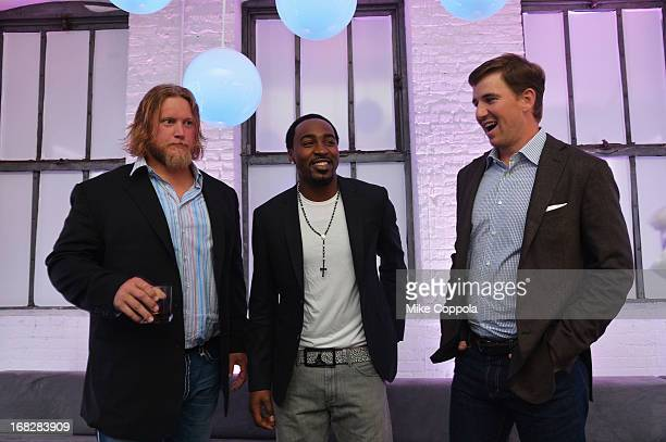 NFL players Nick Mangold Hakeem Nicks and Eli Manning attend DIRECTV's 2013 National Ad Sales Upfront on May 7 2013 in New York City