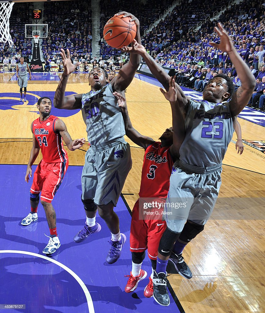 Players Nigel Johnson #23 and D.J. Johnson #50 of the Kansas State Wildcats go up for a rebound over guard Derrick Millinghaus #3 of the Mississippi Rebels during the first half on December 5, 2013 at Bramlage Coliseum in Manhattan, Kansas. Kansas State won 61-58.