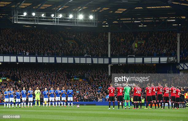 Players observe a minute of applaud to commemorate former Everton manager Howard Kendall prior to the Barclays Premier League match between Everton...