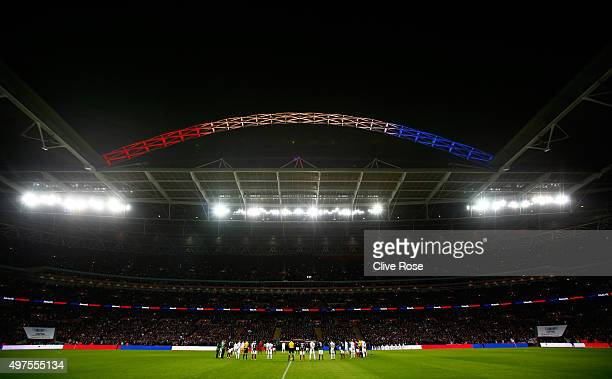 Players observe a minute of silence to remember those who lost their lives in the recent Paris attack prior to the International Friendly match...