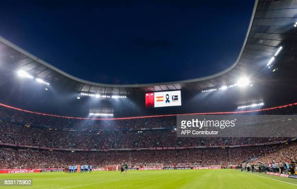 Players observe a minutes' silence for the victims of the attack in Barcelona prior to the German First division Bundesliga football match FC Bayern...