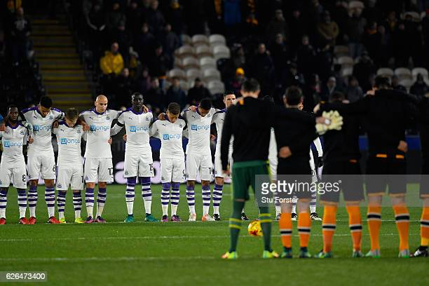 Players observe a minutes silence for the victims of the plane crash involving the Brazilian club Chapecoense prior to the EFL Cup QuarterFinal match...