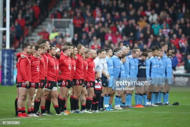 Players observe a minutes silence in honour of Remembrance Day prior to the AngloWelsh Cup match between Gloucester Rugby and London Irish at...