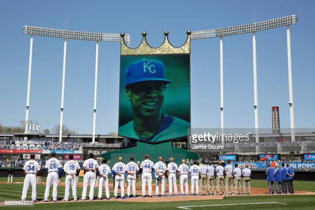 Players observe a moment of silence for deceased pitcher Yordano Ventura prior to the Royals 2017 home opener against the Oakland Athletics at...