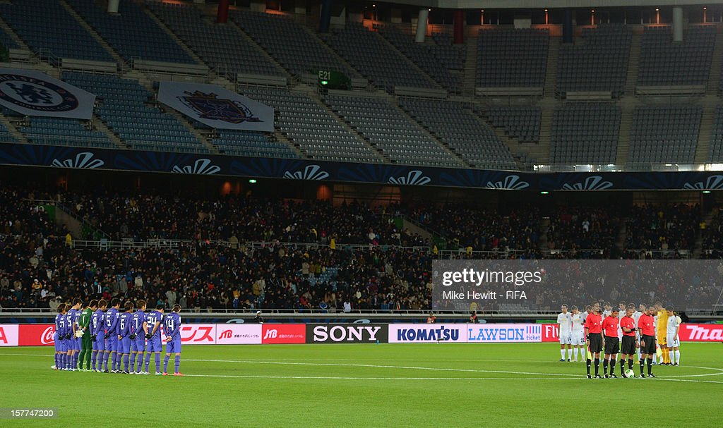 Players observe a silence in honour of Richard Nieuwenhuizen, the Dutch linesman killed during an amateur match, prior to the FIFA Club World Cup match between Sanfrecce Hiroshima and Auckland City at International Stadium Yokohama on December 6, 2012 in Yokohama, Japan.