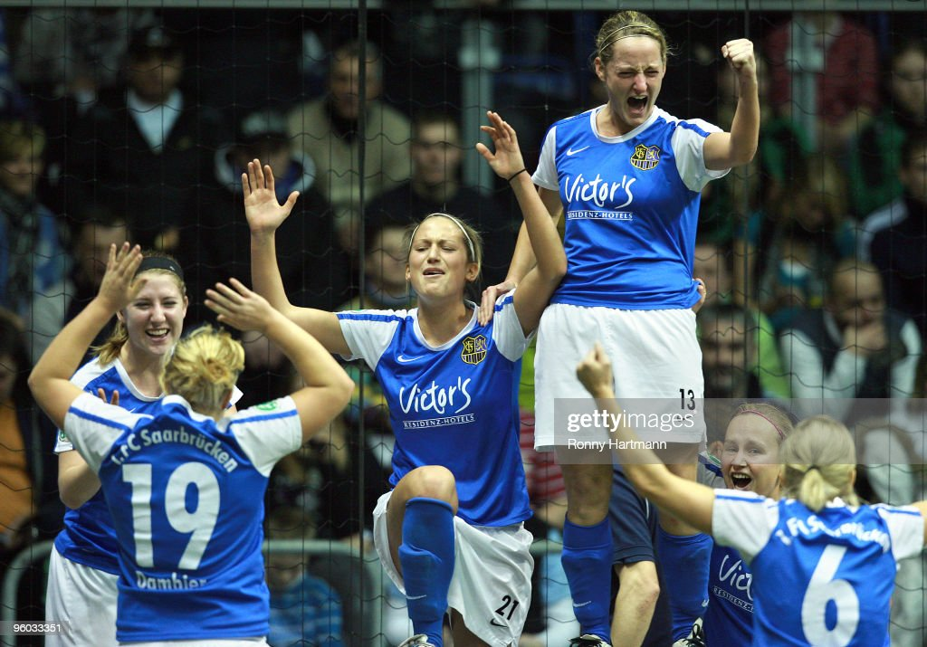 Players of 1. FC Saarbruecken celebrate after winning their quarterfinal against FCR 2001 Duisburg during the T-Home DFB Indoor Cup at the Boerdelandhalle on January 23, 2010 in Magdeburg, Germany.