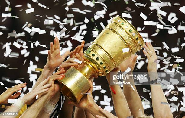 Players of 1FC Nuremburg hold the trophy high in celebration after winning the German Cup Final against VfB Stuttgart at the Olympic stadium on May...