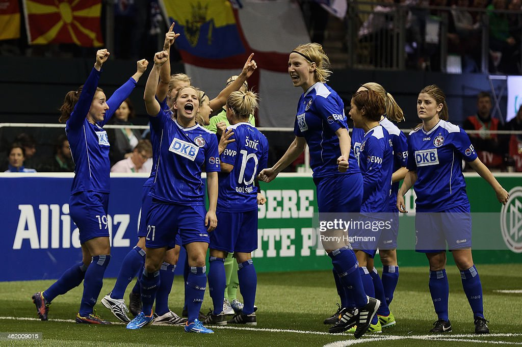Players of 1.FFC Turbine Potsdam 1971 celebrate winning the DFB Women's Indoor Cup 2013 final between 1.FFC Turbine Potsdam 1971 and 1. FFC Frankfurt during the DFB Women's Indoor Cup at GETEC-Arena on January 12, 2014 in Magdeburg, Germany.