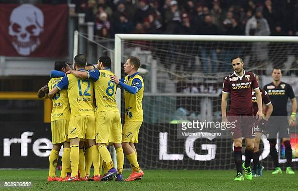 Players of AC Chievo Verona celebrate an own goal by Bruno Peres of Torino FC during the Serie A match between Torino FC and AC Chievo Verona at...