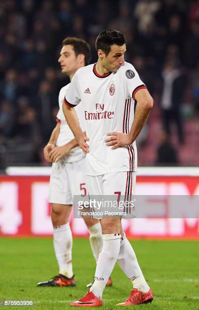 Players of AC Milan Giacomo Bonaventura and Nikola Kalinic show their disappointment after the Serie A match between SSC Napoli and AC Milan at...
