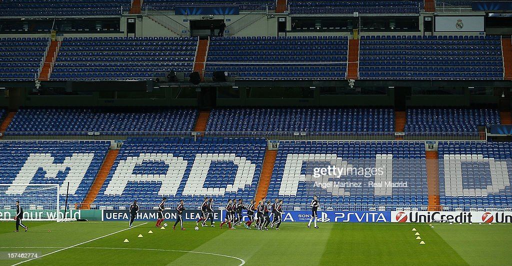 Players of AFC Ajax warm up during a training session ahead of their UEFA Champions League group stage match against Real Madrid at Estadio Santiago Bernabeu on December 3, 2012 in Madrid, Spain.