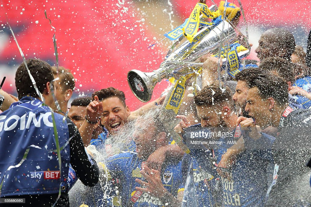 Players of AFC Wimbledon celebrate promotion after victory in the Sky Bet League Two Play Off Final between Plymouth Argyle and AFC Wimbledon at Wembley Stadium on May 30, 2016 in London, England.