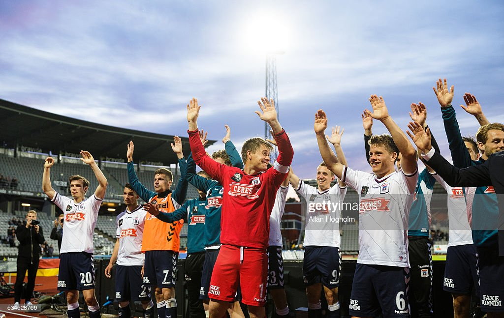 Players of AGF Aarhus celebrate their victory after the Danish Alka Superliga match between AGF Aarhus and OB Odense at Ceres Park on May 26, 2016 in Aarhus, Denmark.