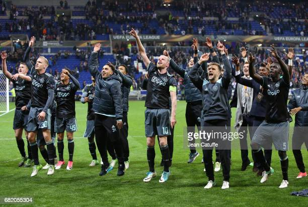 Players of Ajax Amsterdam celebrate the qualification for the Final following the UEFA Europa League semi final second leg match between Olympique...