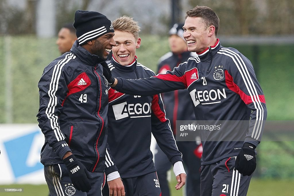 Players of Ajax Amsterdam (L-R) Ryan Babel, Viktor Fischer and Derk Boerrigter laugh during a training session in Amsterdam on January 18, 2013 two days before their Eredivisie match against arch rival Feyenoord Rotterdam. AFP PHOTO / ANP - ED VAN DE POL - netherlands out