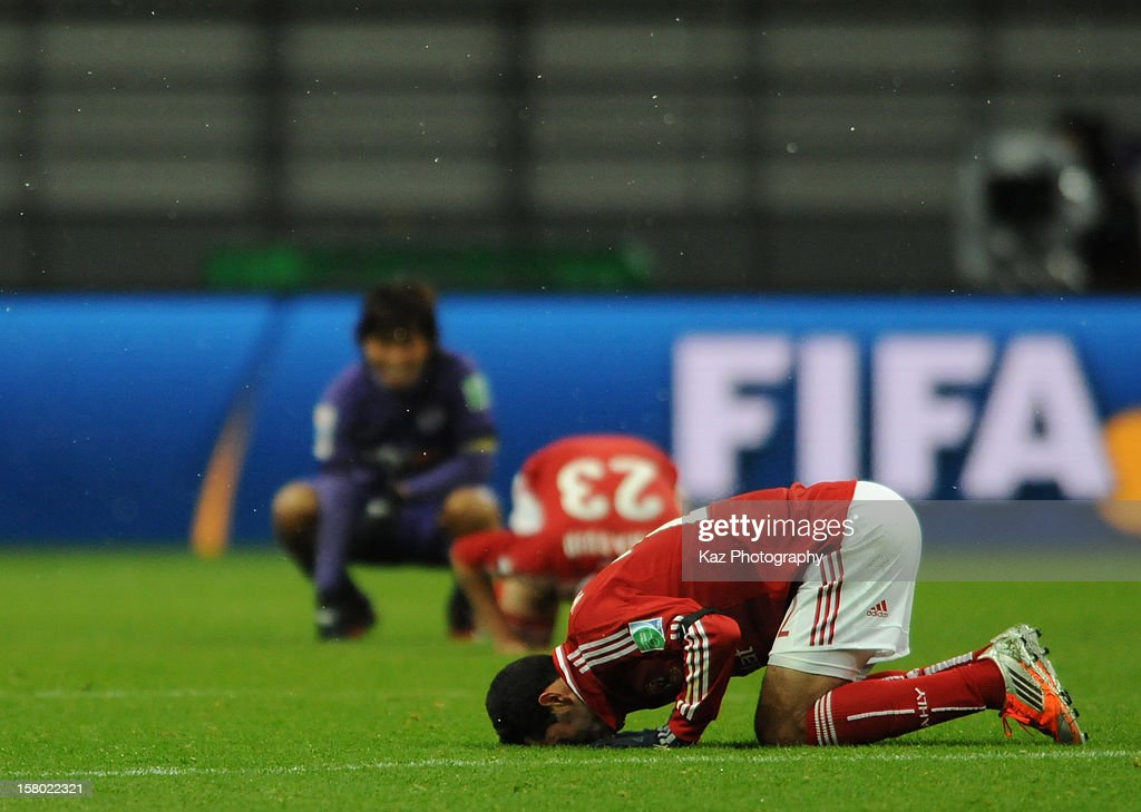 Players of Al-Ahly celebrate their win in Arabic style while Hisato Sato is unhappy with the result during the FIFA Club World Cup Quarter Final match between Sanfrecce Hiroshima and Al-Ahly SC at Toyota Stadium on December 9, 2012 in Toyota, Japan.