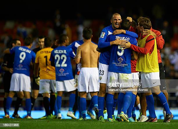 Players of Almeria celebrate the victory after the La Liga match between Valencia CF and UD Almeria at Estadio Mestalla on October 30 2013 in...