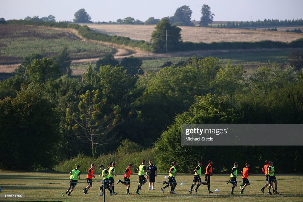 Players of Alresford Town warm up ahead of the FA Cup Extra Preliminary Round match between Alresford Town and Winchester City at Alrebury Park on August 16, 2013 in New Alresford, England.