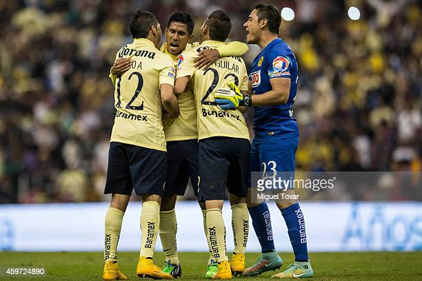 Players of America celebrate after defeating Pumas during a quarterfinal second leg match between America and Pumas UNAM as part of the Apertura 2014...