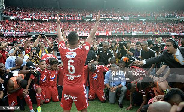 Players of America celebrate promotion to Liga Aguila after winning a match between America de Cali and Deportes Quindio as part of 6th round of...