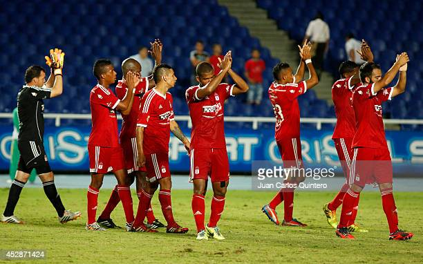 Players of America de Cali greet their fans after winning a match between America de Cali and Cucuta as part of Torneo Postobon 2014 II at Pascual...