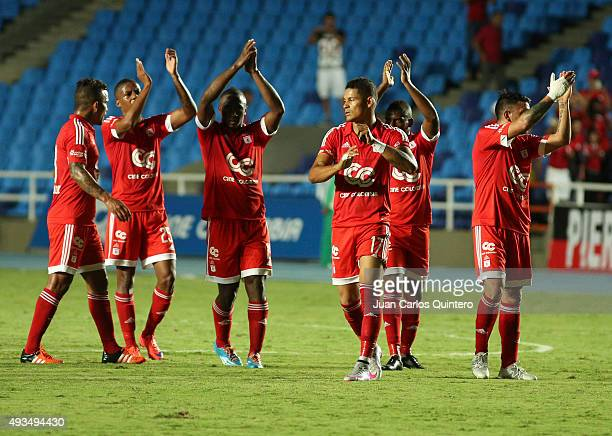 Players of America de Cali show gratitude to their fans after a match between America de Cali and Llaneros FC as part of round 15 of second leg of...