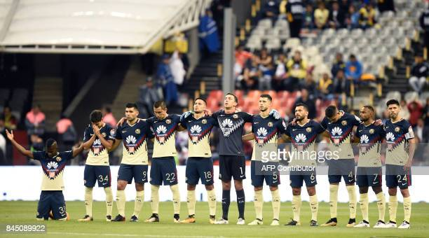 TOPSHOT Players of America keep a minute of silence for the victims of the tremor in Oaxaca and Chiapas during their Mexican Apertura tournament...