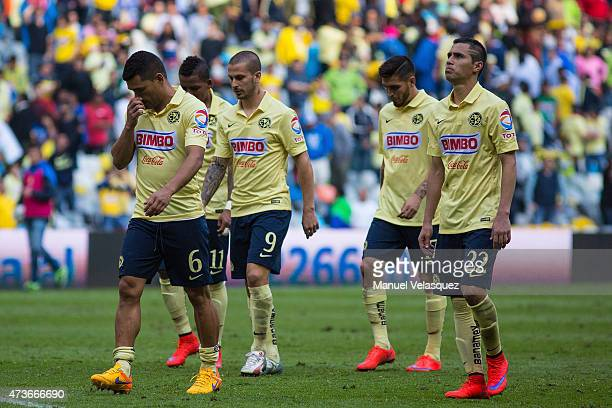 Players of America leave the field after a quarterfinal second leg match between America and Pachuca as part of Clausura 2015 Liga MX at Azteca...