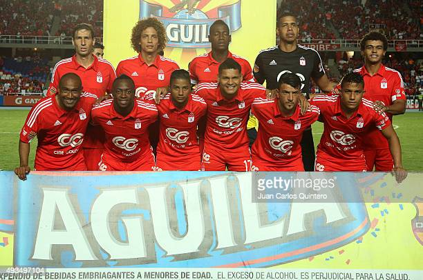 Players of America pose for photos prior a match between America de Cali and Llaneros FC as part of round 15 of second leg of Torneo Aguila 2015 at...