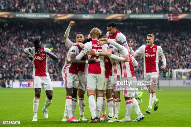 Players of Amsterdam celebrate their teams second goal during the Uefa Europa League semi final first leg match between Ajax Amsterdam and Olympique...