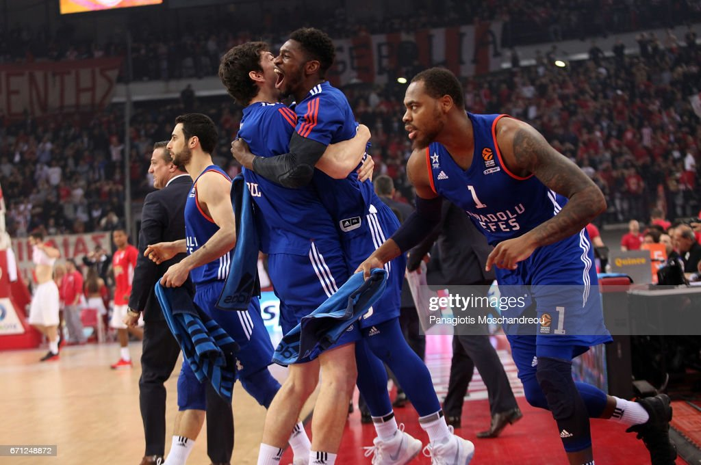 Players of Anadolu Efes Istanbul react after winning the match during the 2016/2017 Turkish Airlines EuroLeague Playoffs leg 2 game between Olympiacos Piraeus v Anadolu Efes Istanbul at Peace and Friendship Stadium on April 21, 2017 in Athens, Greece.