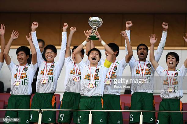 Players of Aomori Yamada celebrate as captain Kakeru Suminaga lifts the trophy during the Prince Takamado Trophy U18 Premier League Championship...