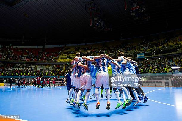 Players of Argentina celebrate after the FIFA Futsal World Cup SemiFinal match between Argentina and Portugal at the Coliseo El Pueblo stadium on...