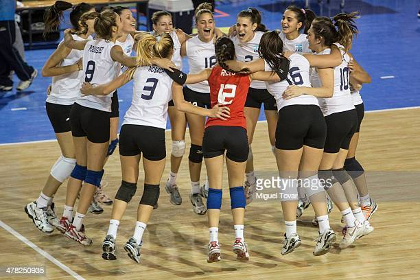 Players of Argentina celebrate after winning the gold medal in women's volleyball as part of day six of the X South American Games Santiago 2014 at...